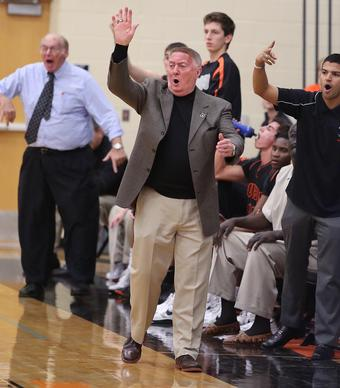 Oviedo High coach Ed Kershner yells during the Evans High at Oviedo High School boys basketball game on Friday, February , 2013.