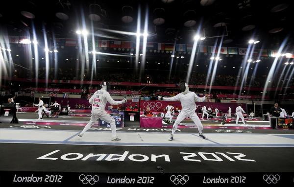 ICao Zhongrong of China, left, and Ondrej Polivka of the Czech Republic compete during the fencing section of the men's modern pentathlon at the 2012 Summer Olympics. The pentathlon is one of the events under consideration for being dropped.