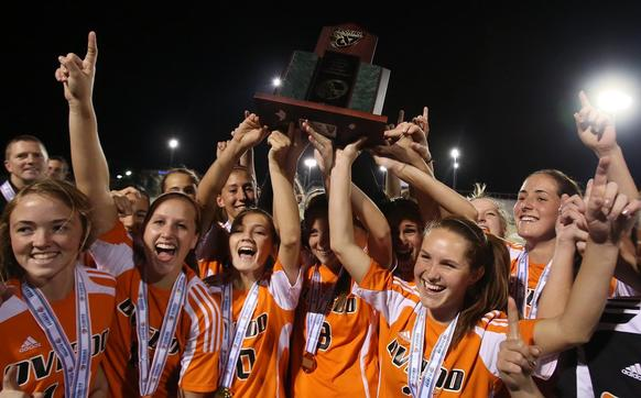 Oviedo players celebrate after winning the girls soccer 5A state championship game of Oviedo High versus Miami Lourdes at Melbourne High School on Saturday, February 9, 2013. Oviedo won the game 1-0 in penalty kicks.