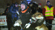 Two Rivers musher Allen Moore claimed his first win in a 1,000 mile sled dog race early Monday morning, capturing the 30th Yukon Quest at 6:54 am in Fairbanks.  Moore was able to hold off runner-up Hugh Neff, whose last minute charge in last year's race defeated Moore by 26 seconds for the title.