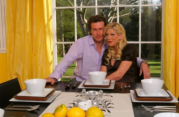 "Dean McDermott, winner of Season 2 of ""Rachael vs. Guy: Celebrity Cook-Off,"" and his wife, Tori Spelling."