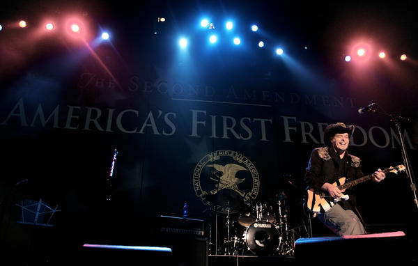 Ted Nugent, seen during the opening ceremony of a National Rifle Association annual convention, will attend this year's State of the Union address.