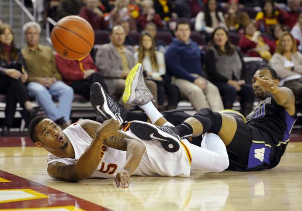 USC's Ari Stewart, left, shown battling for the ball with Washington's Desmond Simmons, will miss up to three weeks because of a broken left hand.