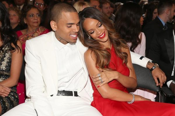 Singers Chris Brown and Rihanna get close at the 55th Grammy Awards on Sunday.