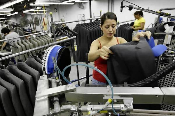 Recent unemployment figures show some improvement in Des Plaines and Park Ridge businesses. In this Tribune file photo from 2009, a woman works at Hart Schaffner Marx factory in Des Plaines.