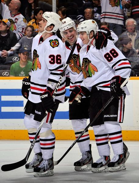 Dave Bolland (from left), Patrick Sharp, Patrick Kane and the rest of the Blackhawks have had plenty to celebrate already, and it's only one-fourth through the season.