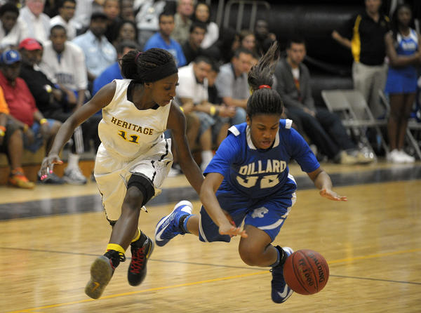 American Heritage guard Raigyne Moncrief and Dillard's Courtney Parson battle for the loose ball during the second half of their game, Wednesday, January 9, 2013.