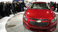 It won't take eye-popping horsepower to get noticed at the 2013 Chicago Auto Show. This year's big McCormick Place breakout comes with a different set of specs.