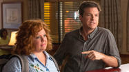 "After its first act, ""Identity Thief"" becomes a predictable, mildly amusing road trip comedy."