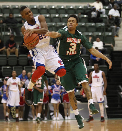 Curie's Joseph Stamps and Morgan Park's Kyle Davis fight for the ball during the Public League quarterfinals.