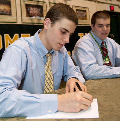 Central Catholic High School athletes signed letters of intent for their respective colleges on Monday afternoon in CCHS Rockne Hall Gym. Pictured are (left to right) Jeff Gulyas, and Andrew Englebert (Football - going to Shippensburg University)
