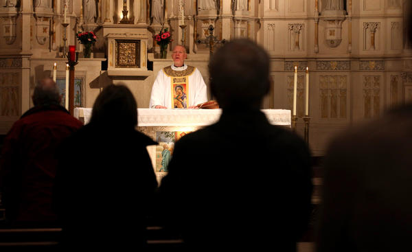 Father Michael O'Connell leads the Monday morning mass 3 at St. Alphonsus Church on Wellington and Southport Avenues in Chicago and talks about the resignation of Pope Benedict.