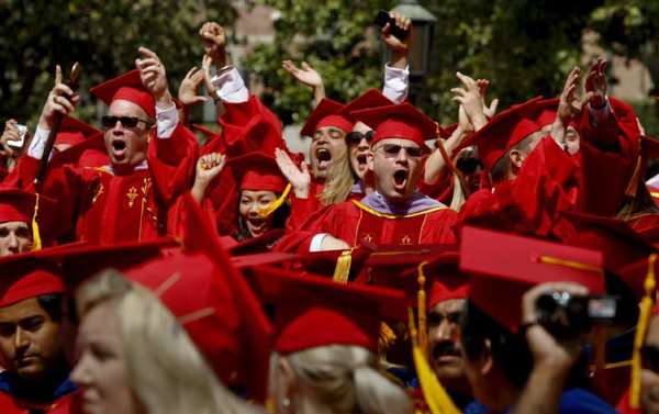 Some of the nearly 14,000 students receiving degrees are among the estimated 40,000 people filling Alumni Park at USC for the 129th annual graduation ceremony.