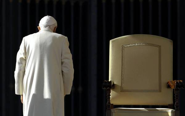 Pope Benedict XVI leaves at the end of his weekly audience in Saint Peter's Square at the Vatican November in this 2011 file photo. Benedict has said he will resign on Feb. 28 because he no longer has the strength to fulfill the duties of his office.