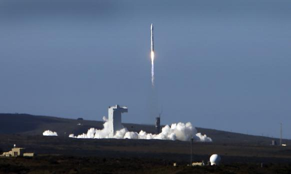 The Atlas V rocket carrying a NASA and USGS Landsat 8 satellite lifts off from Vandenberg Air Force Base.