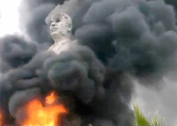 An image from video shows a statue of Hafez Assad, the late father of Syrian President Bashar Assad, on fire in Raqqah province after rebels seized a nearby dam.