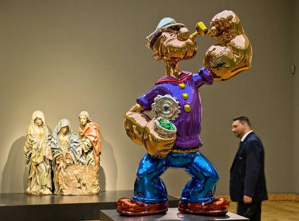 This colorful Popeye is not the Sailor Man in question but is another by artist Jeff Koons.
