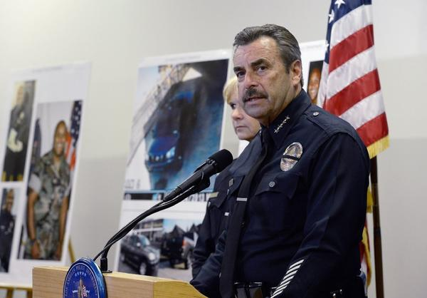 Los Angeles Police Department Chief Charlie Beck, seen here at a news conference last week, has announced the LAPD will reopen the case that led to Christopher Jordan Dorner's firing.