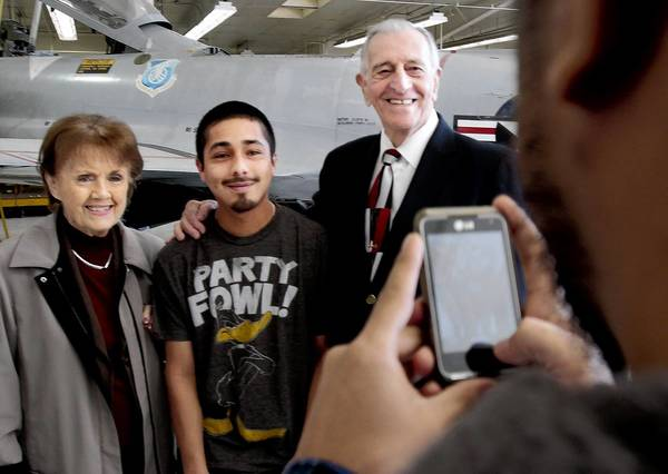 Isac Ramos, 23, center, poses with Betty and Si Robin after a news conference to announce that the owners of Sensor Systems, which makes aircraft antenna, will donate $100,000 to the Aviation Center. Ramos will soon graduate from the two-year program.