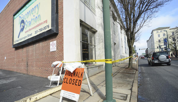 The sidewalk on the Summit Avenue side of the Discovery Station along is closed due to some deterioration of the bulding's marble facade which fell on Sunday.