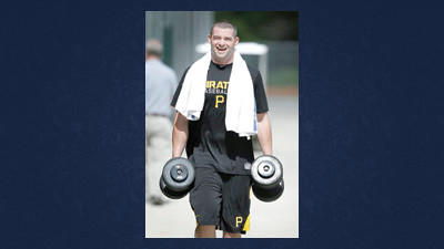 Pittsburgh Pirates first baseman Matt Hague carries weights during a baseball spring training workout Monday in Bradenton, Fla.