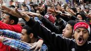 CAIRO (Reuters) - Protesters demanding the departure of Egyptian President Mohamed Mursi clashed with police outside his palace on Monday on the second anniversary of the overthrow of veteran autocrat Hosni Mubarak.