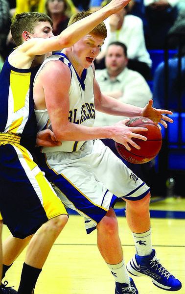Clear Spring's Jacob Brant, right, gathers himself to make a drive to the basket against a Berkeley Spring defender on Monday during the Blazers' 65-52 victory.