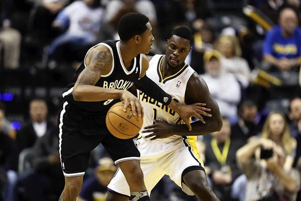 Indiana Pacers guard Lance Stephenson (1) guards Brooklyn Nets guard MarShon Brooks.