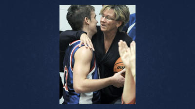Richland's Kyle Flick gets a kiss from mother Kelly after giving her the game ball. Flick reached the 1,000-point plateau Monday night in Davidsville.