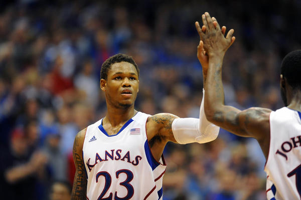 Kansas Jayhawks guard Ben McLemore (23) is congratulated by Kansas Jayhawks guard Elijah Johnson.