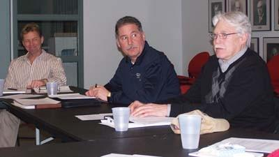 Petoskey clerk-treasurer Al Terry (from left) and public safety director John Calabrese listen as city council member John Murphy makes a comment Monday during the annual city goal-setting session.