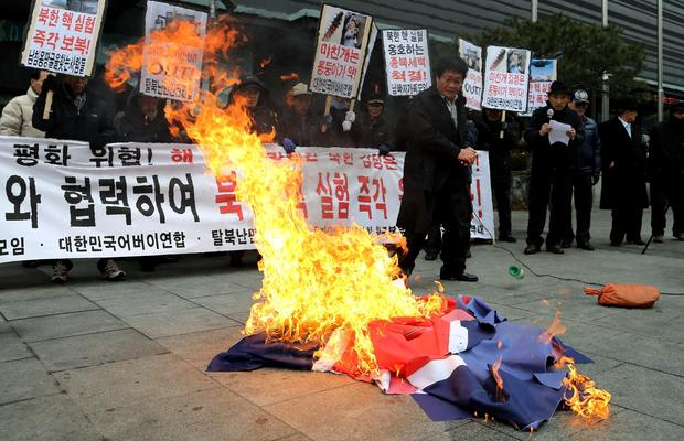 Protesters burn a North Korean flag during a demonstration in Seoul.