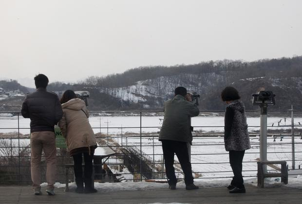 South Koreans use binoculars to look at the North Korea near the demilitarized zone of Panmunjom.