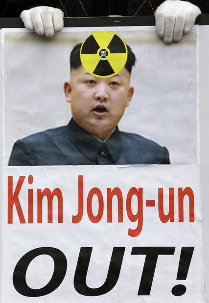 A protester in Seoul holds a picture of North Korean leader Kim Jong Un during an anti-North Korea rally following a report of the nuclear test conducted by North Korea.