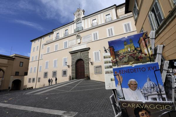 Photo calendars of Pope Benedict XVI are sold outside the pope's summer residence of Castel Gandolfo, south of Rome, where Benedict will temporarily move after he steps down on Feb. 28 while permanent lodgings are prepared at the Vatican.
