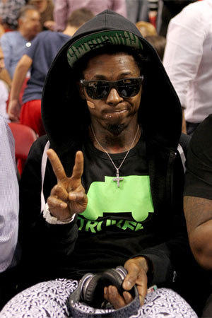 Rapper Lil Wayne, shown during Wednesday's game between the Miami Heat and Houston Rockets, claims to have been ejected from Sunday's Heat-Lakers game.