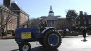 "Farmers and others upset over state-imposed restrictions on septic-based rural development staged a ""tractorcade"" Tuesday past the State House in Annapolis."