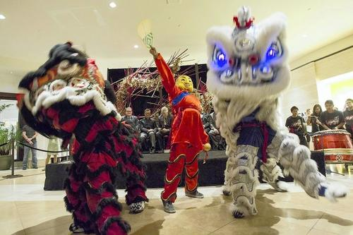 Members of the Southern Wind Lion Dance group perform the Lion Dance during a celebration of the Lunar New Year at South Coast Plaza on Thursday.