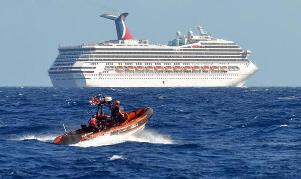 A small boat from the U.S. Coast Guard Cutter Vigorous patrols near the cruise ship Carnival Triumph in the Gulf of Mexico.