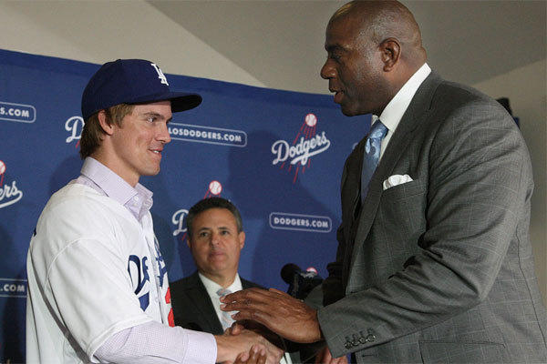 Zach Greinke, left, with co-owner Magic Johnson, is one of the many free-agents the Dodgers signed with an eye on a World Series championship.