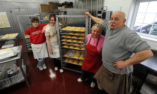 Karen Drake and Skip Drake (right) co-owner of Tomblers Home Bakery in Easton, along with Mary Bisher (left) and Shelby Tretter (left center) both bakers, in their new bakery in Easton.