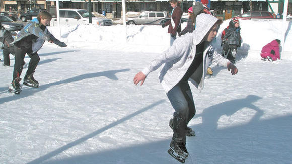 An outdoor skating rink on the lawn of the Otsego County Building was a popular Alpenfrost destination.