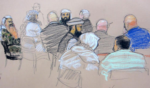 In this Pentagon-approved sketch, five accused Sept. 11 plotters confer with attorneys after court convened on Monday in Guantanamo Bay, Cuba.
