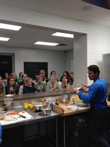 Italian Chef Marco Palazzo provides a cooking class to eighth-grade members of the National Charity League.