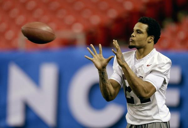 Alabama running back Brent Calloway warms up for a game in October. He is accused of stealing a student's wallet.