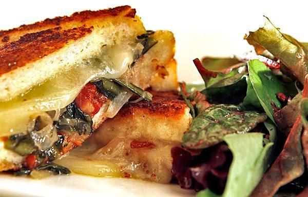 Savory French toast is stuffed with cheese, bacon and greens.