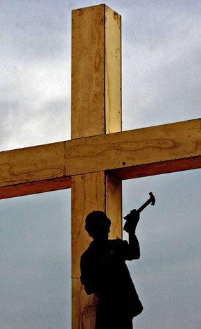 A worker in Sao Paulo, Brazil, puts the finishing touches on a cross in preparation for the 2007 visit by Pope Benedict XVI.