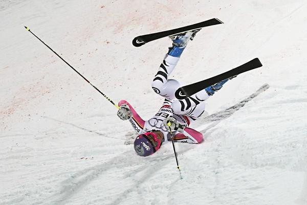 Maria Hoefl-Riesch of Germany crashes during the national team event at the World Alpine Skiing Championships in Schladming February 12, 2013.