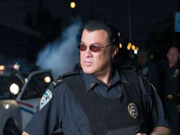 "Actor Steven Seagal, in a scene from the A&E show ""Steven Seagal Lawman,"" is helping teach Arizona Sheriff Joe Arpaio's armed volunteers how to handle school shootings."