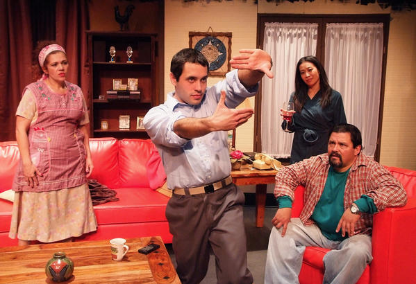 "Sonny Villa (Alex Valdivia), center, explains his to his mother, Connie (Carmelita Maldonado) and father, Buddy (Daniel E. Mora), why he wants to drop out of Harvard to become a filmmaker, as his love interest, Anita Sakai (Elizabeth Pan) looks on in ""I Don't Have to Show You No Stinking Badges"" at Casa 0101."
